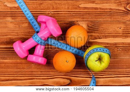 Centimeter With Dumbbells Weight And Apple, Orange For Diet Concept