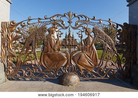 Large wrought iron gates to the temple complex of the village of Buki