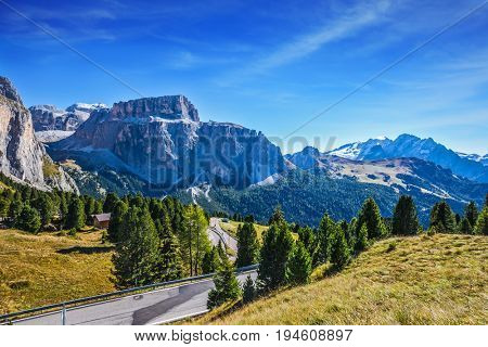 Ridge of dolomite rocks. Picturesque highway through the Sella Pass. Autumn in the Tirol, Dolomites. The concept of ecological and extreme tourism