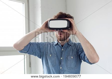 amazed man wearing VR virtual reality goggles