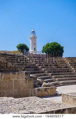 Antient greek amphitheater and lighthouse in Archeological park in Paphos, Cyprus
