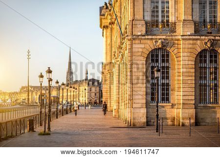 Street view ner the famous La Bourse square during the morning in Bordeaux city, France