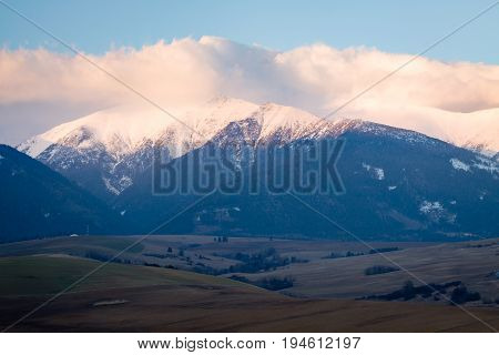 Foothills in Tatra Mountains Slovakia with snowy peaks.