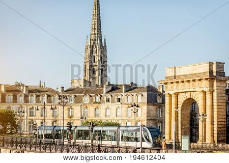 Seaside view on the famous Bourgogne gates and tower of saint Michel cathedral during the morning light in Bordeaux city, France