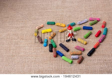 Pinocchio In The Middle Of Crayons  Heart