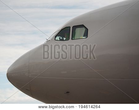 From the cockpit of a passenger airliner the pilot waves his hand