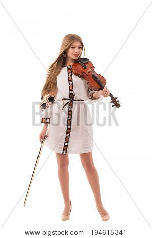 Young woman in ukrainian folk costume with violin isolated on white background.