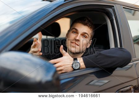 Man Driver Waves His Hands And Asks A Question. Emotion Of Surprise