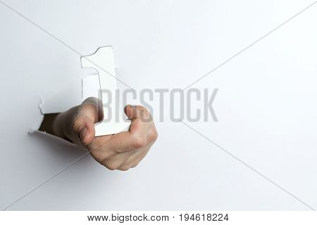 Female Hand Holding A Number One White Background.