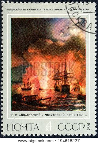 UKRAINE - CIRCA 2017: A postage stamp printed in USSR shows a painting Battle of Chesme by Ivan Aivazovski from the series Russian Paintings circa 1974