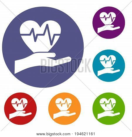 Hand holding heart with ecg line icons set in flat circle reb, blue and green color for web