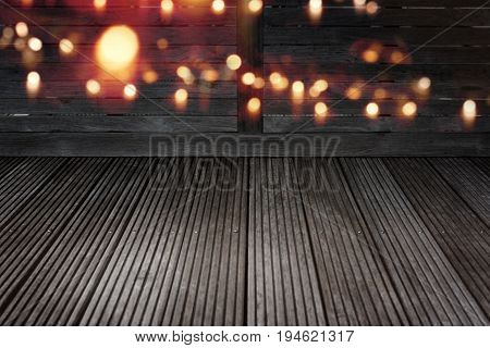 Golden bokeh background on dark shabby wood for a summer night concert