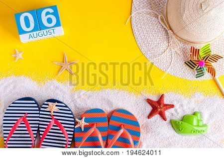 August 6th. Image of august 6 calendar with summer beach accessories and traveler outfit on background. Summer day, Vacation concept.
