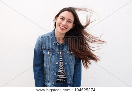 Happy Woman In Denim Jacket With Long Hair Blowing