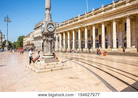 BORDEAUX, FRANCE - May 26, 2017: View on the Comedy square crowded with people and Grand Theatre building in Bordeaux city during the sunny day in France
