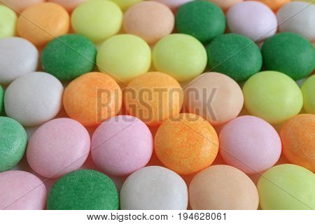Lined up Colorful Round Candies with Selective Focus for Texture, Background