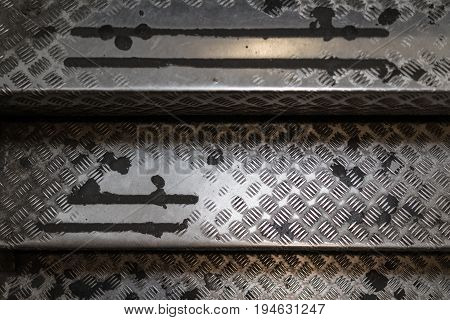 Old aged used steel stair case ladder with pattern texture.
