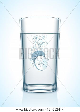Medicine tablet pills in transparent glass of water