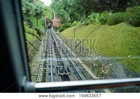 View of a tram tracks at Penang Hill Malaysia during a rainy day.A favourite tourism spot among locals and foreign tourists.