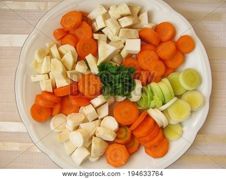 Dice from celery, leek, root parsley, celery green and carrots