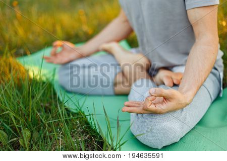Fitness, Sport, Yoga And Healthy Lifestyle Concept - Close Up Of People Meditating In Easy Sitting P