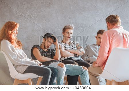 Group of young people at the psychotherapy session with counselor
