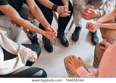 Troubled teenagers meeting with a therapist to solve their issuespsychotherapy concept