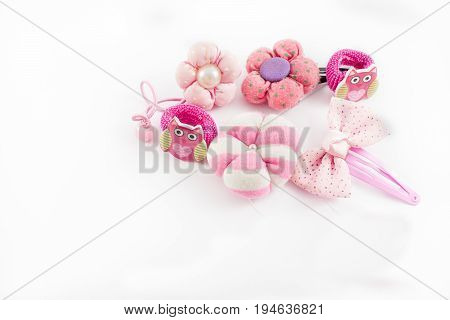 Girl hair accessories such as buckles elastic bands bows scrunchies with different shapes on a white background.