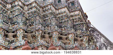 Demon Guardian Statues at pagoda of Temple of Dawn, Wat Arun, Bangkok, Thailand. Magnificent Architecture of Wat Arun
