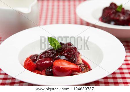 Steamed fruit pudding A steamed fruit pudding covered with summer fruits