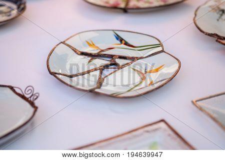 Kintsugi Style Handcrafted Plate Sold At Handicraft Market. Tel-aviv. Israel, Kintsugi Is The Japane
