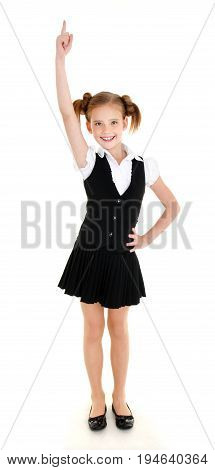 Smiling happy school girl child in uniform showing to the up isolated on a white background