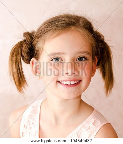 Portrait of adorable smiling happy little girl child isolated