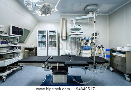 MOSCOW - DECEMBER 14, 2016: Empty modern operating room with medical equipment.