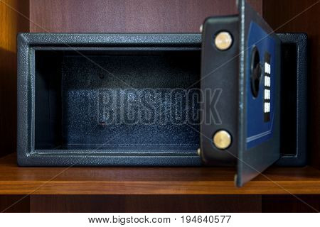 Open empty safe box in home or hotel room