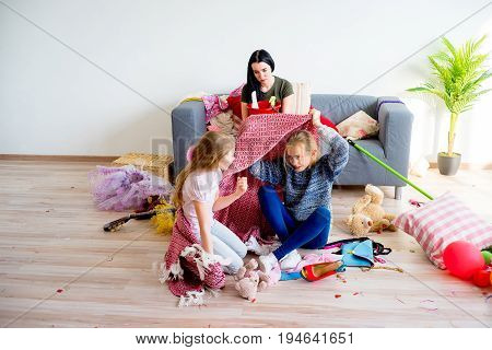 Two sisters romping playing creating a mess