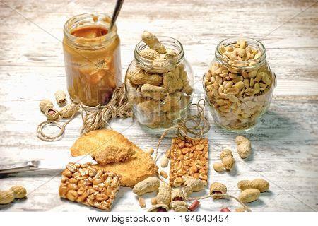 Organic peanut, peanuts in shell, peanut butter and sweet peanut tiles (peanut chips)