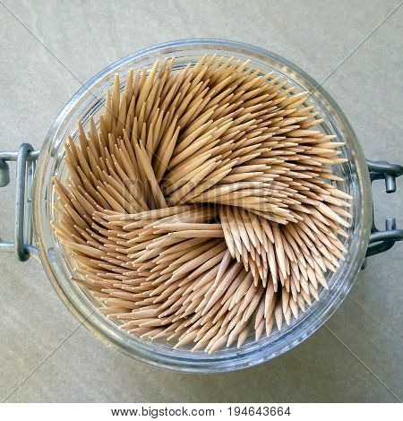 aerial view of a group of toothpicks in a glass jar