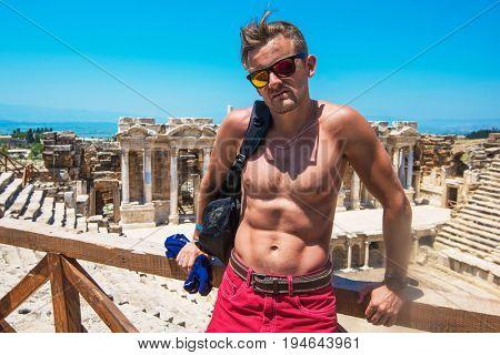 Portrait of man in ancient theatre in the city Hierapolis, near modern turkey city Denizli