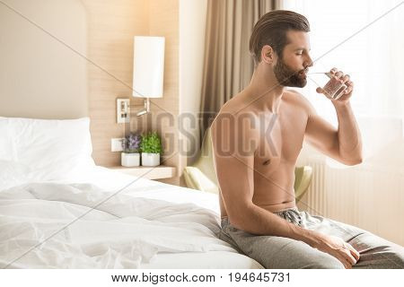 Young male traveler tourist hotel accomodation drinking water