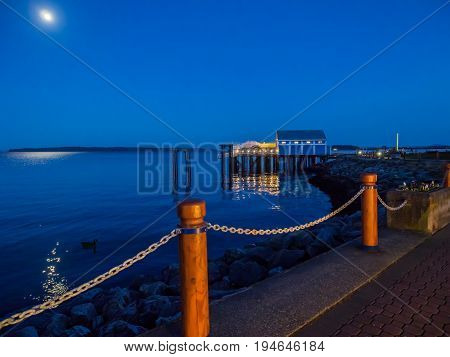 Seawalk on a clear night in Sidney Vancouver Island British Columbia moon rising