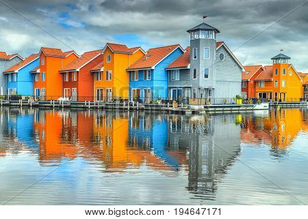 Amazing colorful buildings on water at haven Groningen Netherlands Europe