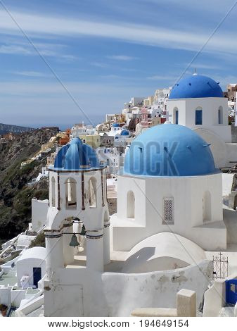 Greek Islands traditional white and blue churches at Oia village on Santorini island, Greece