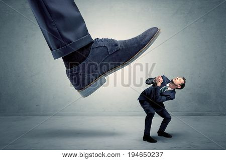 Demoralised employee symbolized by small man getting trampled
