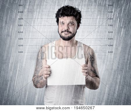 Gangster with rainy, lowering background and table on his hand.