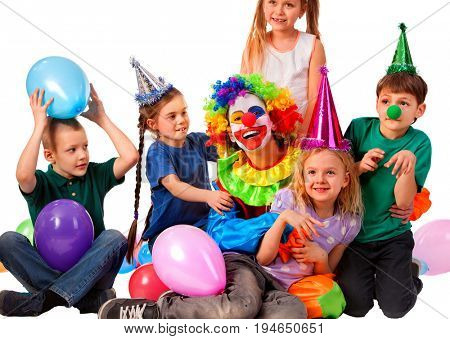 Birthday child clown playing with children . Kid wearing party hat hold balloons happiest birthday. Fun of group people pose for camera on white background. Holiday for children in kindergarten.