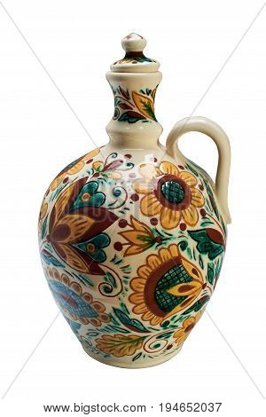 Colorful covered with glaze ceramic handmade bottle. Painting in the technique Kosovo ceramics - it really authentic Ukrainian technique of painting on clay. Isolated on a white background