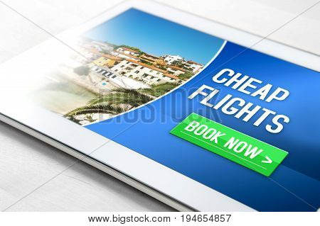 Cheap flights for sale on internet. Close up of tablet on table with affordable and inexpensive vacation offer on screen. Imaginary low cost carrier business application on mobile device. Book now.
