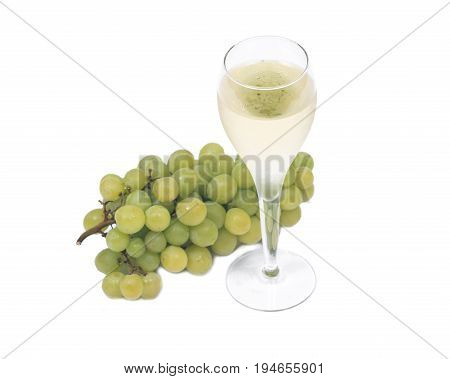 Glass of white wine and ripe organic green grapes isolated on white background