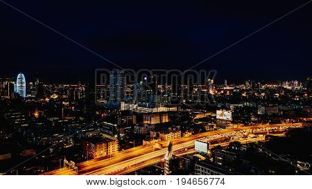 Cityscape And Light Of Night Road In Long Exposure